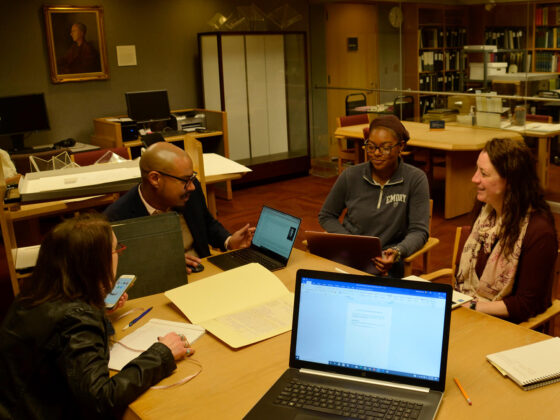"""Consulting curators Jesse Erickson and Monet Timmons meet with the Rosenbach exhibitions team to discuss artifacts for inclusion in """"I Am an American!"""", February 13, 2020."""