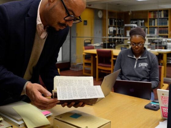 Exhibition co-curator Jesse Erickson shares an artifact with the Rosenbach exhibition team, University of Delaware Library, February 13, 2020.